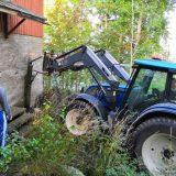 Sydänlammin kyläyhdistys korjaa aitaa Untulassa